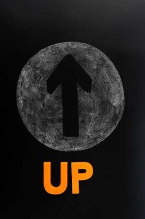 Arrow of up drawn on a blackboard Stock Photo - 12389497