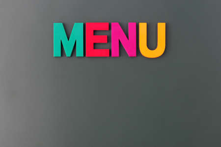 Menu of colorful letters on a background of blackboard photo