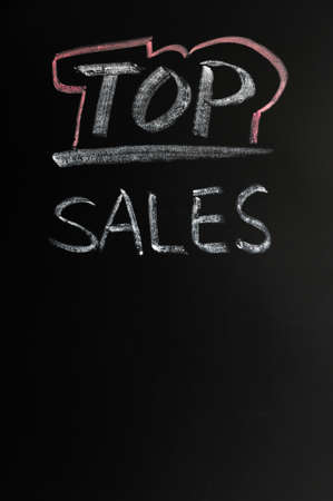 Top sales written in chalk on a blackboard Stock Photo - 12389529