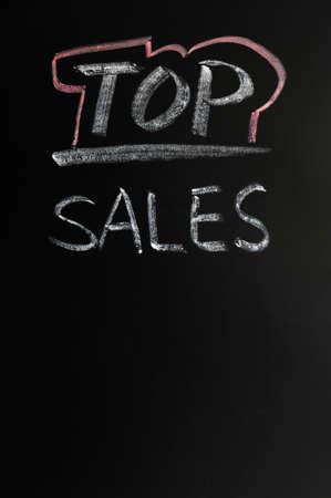Top sales written in chalk on a blackboard Stock Photo - 12389529