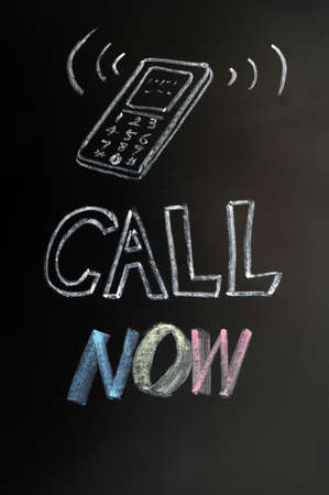 Call now - text written in chalk on a blackboard Stock Photo - 12389539