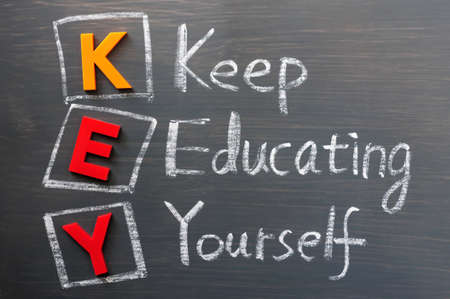 keep: Acronym of KEY on a blackboard- Keep Educating Yourself
