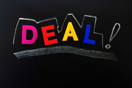 Deal concept made of colorful letters on a blackboard photo