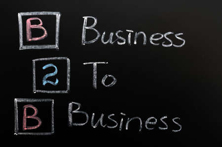 Acronym of B2B concept - Business to Business written in chalk on a blackboard  photo