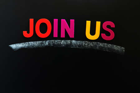 Join us - text made of colorful letters on a blackboard photo