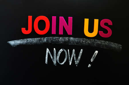 Join us now- text made of colorful letters on a blackboard photo