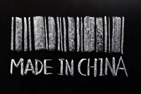 made in china: Bar code of Made in Chinawritten with chalk on a blackboard Stock Photo