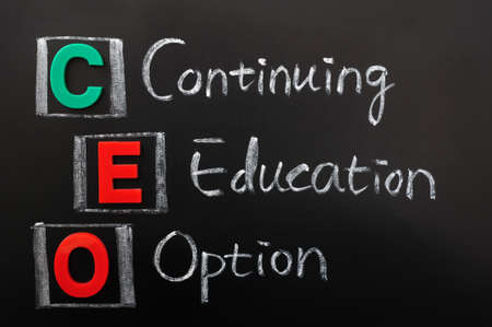 continuing education: Acronym of CEO - Continuing Education Option written in chalk on a blackoard