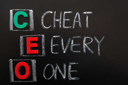 Acronym of CEO - Cheat Every One written in chalk on a blackoard Stock Photo - 12389553