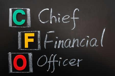 cfo: Acronym of CFO - Chief Financial Officer written in chalk on a blackboard