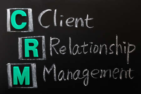 customer relationship: Acronym of CRM - Client Relationship Management written on a blackboard