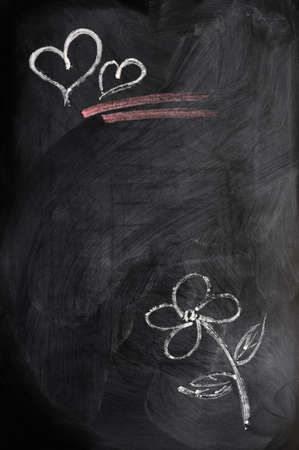 Hearts and flower drawn in chalk on a blackboard photo
