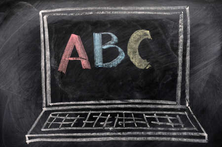 Chalk drawing of Laptop with ABC on the screen photo