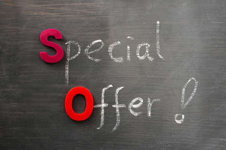 Special offer written in chalk on a blackboard Stock Photo - 12389760