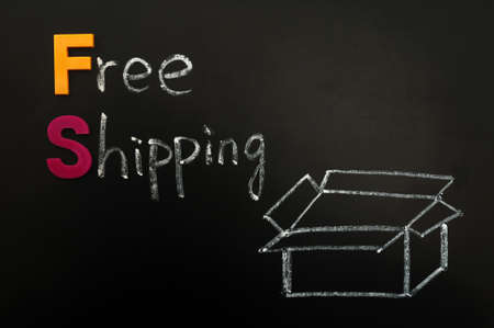 Free shipping concept drawn in chalk on a blackboard photo