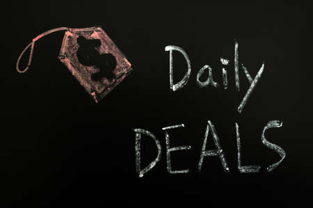 Daily deals concept written on a blackboard