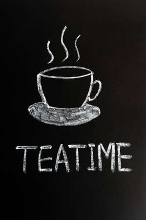 Chalk drawing of teatime with a cup on a blackboard photo