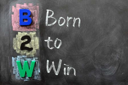 Acronym of B2W - Born to Win written on a blackboard
