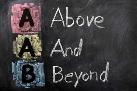 beyond: Acronym of AAB for Above and Beyond written in chalk on a blackboard