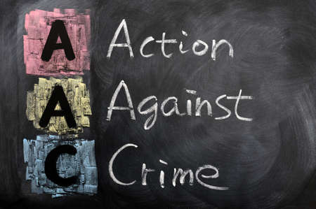 Acronym of AAC for Action against Crime  written in chalk on a blackboard Stock Photo - 12389719