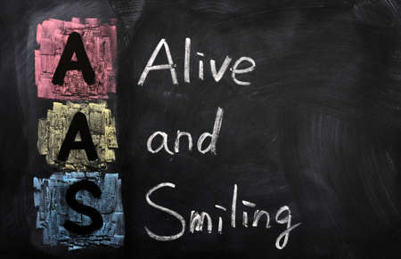 aas: Acronym of AAS for Alive and Smiling written in chalk on a blackboard Stock Photo