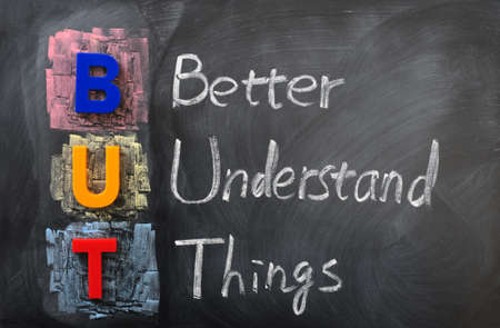 Acronym of BUT for Better Understand Things written in chalk on a blackboard Stock Photo - 12389702