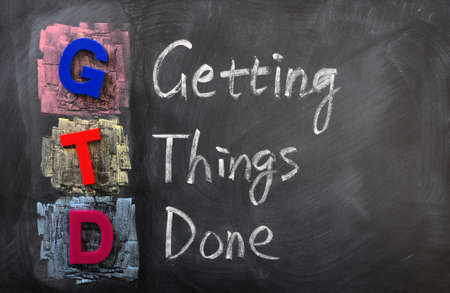 Acronym of GTD for Getting Things Done written in chalk on a blackboard
