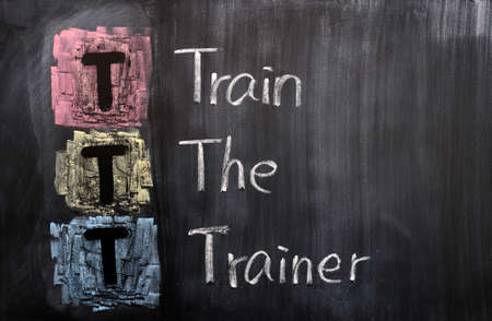 Acronym of TTT for Train the Trainer written on a blackboard Stock Photo