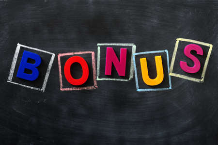 Word of Bonus made of colorful letters on a blackboard Stock Photo - 12389651