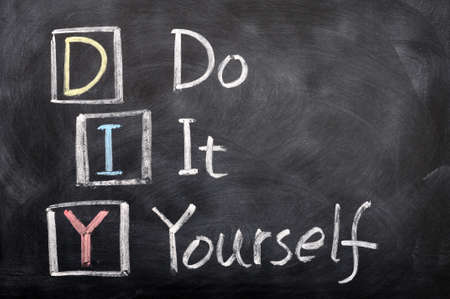 Acronym of DIY for Do It Yourself written with chalk on a blackboard Stock Photo - 12389659