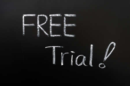 trial: Free trial - words with a big exclamation mark written with chalk on a blackboard Stock Photo