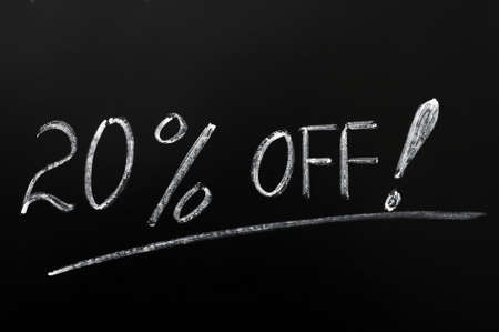 20% off discount written in chalk on a blackboard Stock Photo - 12389661