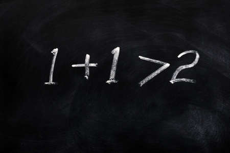 greater: One plus one is greater than two written on a blackboard