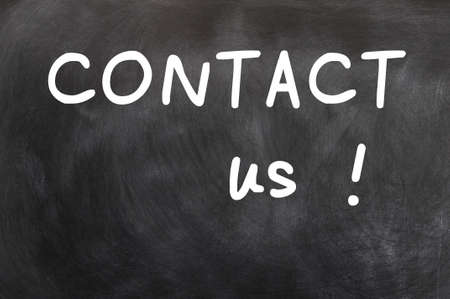 Contact us written with white chalk on a blackboard Stock Photo - 12825161