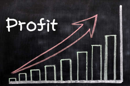 Charts of profit written with chalk on a blackboard Stock Photo - 12825173