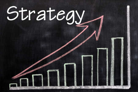 Charts of strategy written with chalk on a blackboard Stock Photo - 12825174