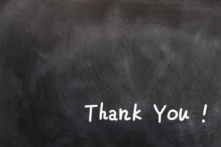 Thank you written in chalk on a blackboard with copy space for extra text photo