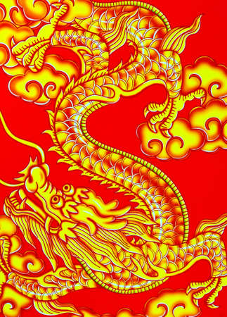 Golden dragon on a red background photo