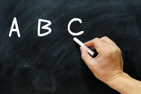 Blackboard / chalkboard. Hand writing ABC with chalk