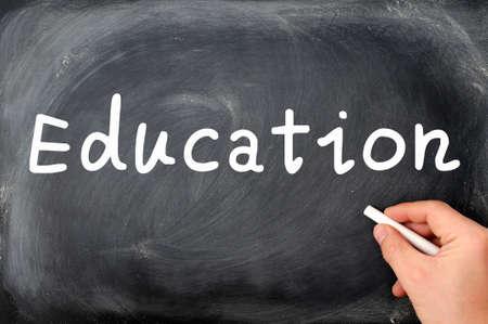 Education written with chalk on a blackboard background photo