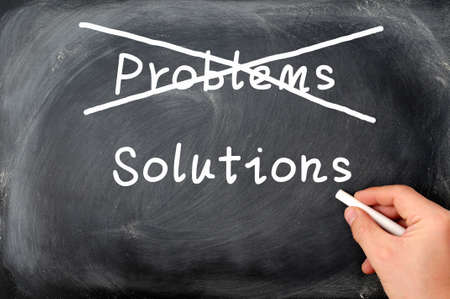 problems solutions: Problems and solutions written on a blackboard background