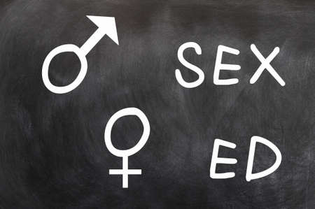 sex education: Sex education with gender symbols written with chalk on a blackboard