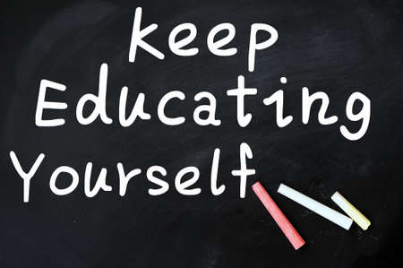 Acronym of KEY for Keep Education Yourself written with chalk on a blackboard photo