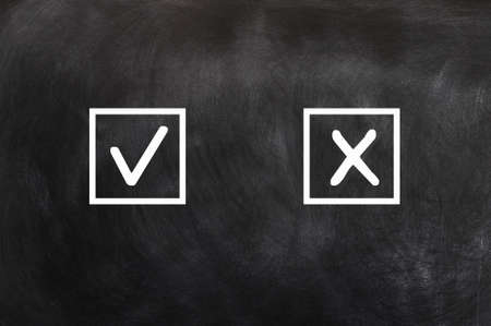 wood tick: Check boxes with tick and cross on a blackboard