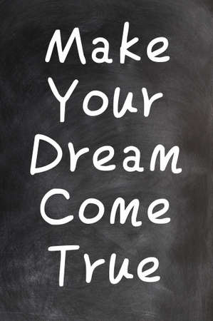 Make your dream come true - text written with chalk on a blackboard photo