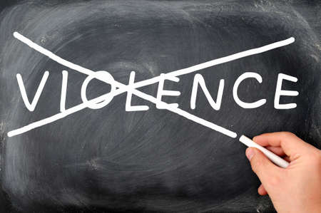 No violence concept on a blackboard, crossing out by chalk Stock Photo - 12947233