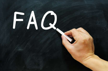 FAQ written with chalk on a chalkboard photo
