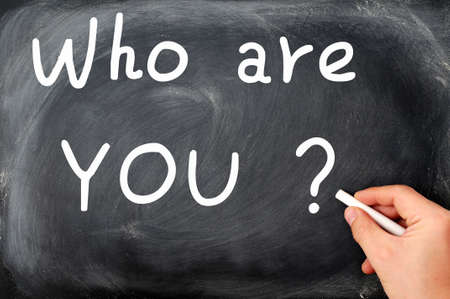 Who are you question written with chalk on a blackboard photo