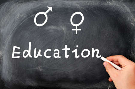 sex education: Sex education concept with gender symbols written on a blackboard Stock Photo