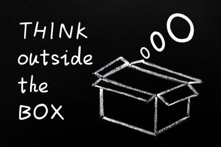 Think outside the box - Concept drawn in chalk on a blackboard photo